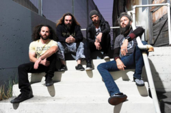 From left to right: former drummer Dave Elitch, Max Cavalera, Greg Puciato, and Troy Sanders.