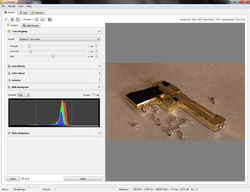 A screenshot of Luxrender 0.7 Rendering a Desert Eagle