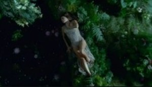 Meet Me Halfway - Fergie is shown in a luxuriant forest