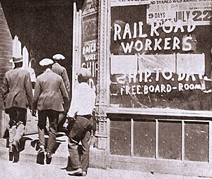 """Great Railroad Strike of 1922 - Office for the recruiting of strikebreakers in the 1922 Shopmen's Strike. Strikebreakers were frequently domiciled and fed on site to avoid having to cross picket lines, leading to promises of """"Free Board – Room"""" in the painted window."""