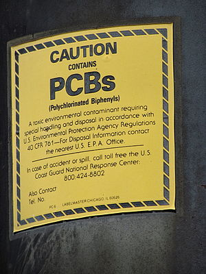 Polychlorinated biphenyl - PCB warning label on a power transformer known to contain PCBs.