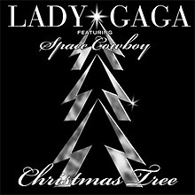 "A platinum outline of a Christmas tree with a silver star at the top in front of a black background. Above it are the words ""Lady Gaga"" written in silver and the words ""featuring Space Cowboy"" written below that in italic silver. Below the tree are the words ""Christmas Tree"" in italic silver text."