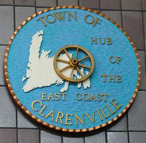 Clarenville - A wood carving of the town seal of Clarenville on display at Memorial University of Newfoundland.