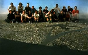 You, the Living - Crew posing on the large city model used in the film's final shot.