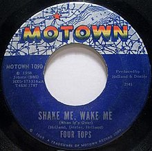 A blue vinyl record of the single appears