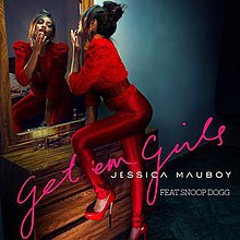 A black background and a green floor and a orange little wardrobe and the red woman. Performer is 'JESSICA MAUBOY FEAT. SNOOP DOGG' and pink word is 'get' em girls'