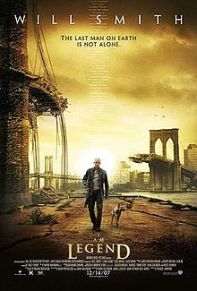 "A man wearing leather clothes and holding a rifle walks alongside a dog on an empty street. A destroyed bridge is seen in the background. Atop the image is ""Will Smith"" and the tagline ""The last man on Earth is not alone"". Below is the film's title and credits."