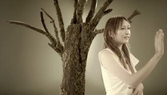 """Ai no Melody/Chōwa Oto (With Reflection) - Kokia in the music video for """"Ai no Melody."""""""