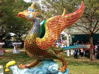 Burung Petala Processions - A contemporary form of Burung Gagak Sura from Pattani. The vibrant colours and glossy finish of the bird is parallel to the historical giant processional birds.