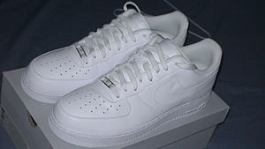 "Air Force (shoe) - A pair of ""white-on-white"" retro low-top Air Force 1s"