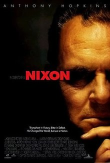 "A face half hidden in shadows, his hand on his chin. ""Nixon"" is written in red letters in the center of the poster."