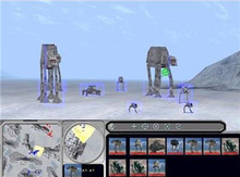 The top two-thirds of the screen depicts gameplay of Imperial walkers and other vehicles moving across an icy surface. The bottom third of the screen features a map and various player controls.