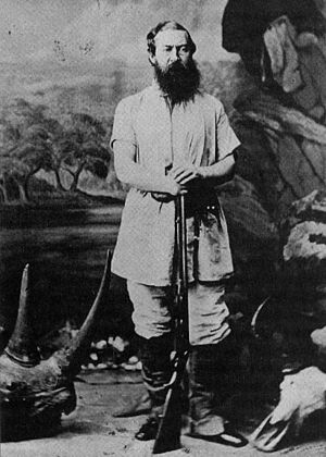 Imatong Mountains - Sir Samuel Baker in hunting attire with trophies of rhino and buffalo.