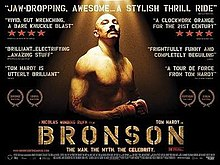 A muscular man, illuminated in sunlight and wearing boxing gloves, glances at the camera. The film's title is shown in golden bold text at the bottom of the image and various critic's reviews are displayed around the image.