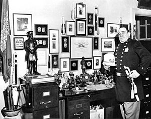 Jay Irving - Jay Irving with his collection of police memorabilia dating back 300 years. He is wearing a vintage uniform with a Pottsy sergeant badge and holding an ivory and rosewood dress baton.