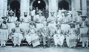 Radala - A group of British appointed Kandyan chiefs, with Hon. J. P. Lewis, Government Agent in 1905. The chiefs have adopted the dress of traditional Dissawas by this time but still haven't started using other traditional insignia of high office such as jewelry, ceremonial daggers or footwear.