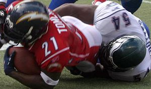 Jeremiah Trotter - Trotter tackling LaDainian Tomlinson at the 2006 Pro Bowl.