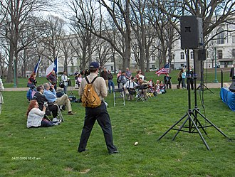 Free Republic - Jim Robinson, waving the American flag at right, musters about two dozen other Freepers for the March for Justice II rally at the Upper Senate Park on the United States Capitol grounds on Thursday, April 7, 2005.