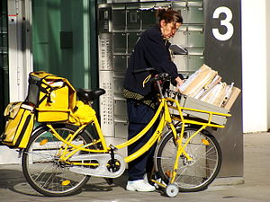 Utility bicycle - Deutsche Post delivery bike in Cologne.