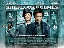 "Robert Downey, Jr. and Jude Law, in-character. The background is a window display, featuring shelves containing miscellaneous objects relating to the story. The poster reads ""Sherlock Holmes"" across the top, with the tagline ""Holmes for the holiday"" centered at the bottom. The poster is predominately turquoise coloured."