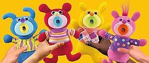 Four Sing-a-ma-jigs dolls