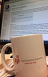 Coffee mug with Equal Justice Initiative logo.jpg