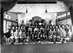 Crystal City Internment Camp - Actors and others at Girl Scout dramatic presentation at Hinamatsuri (Doll's Festival) on Japanese Girl's Day on stage at Crystal City Internment Camp, Crystal City, Texas, 1943-45