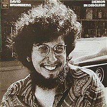 Black and white close-up of David Bromberg, photographed on the street