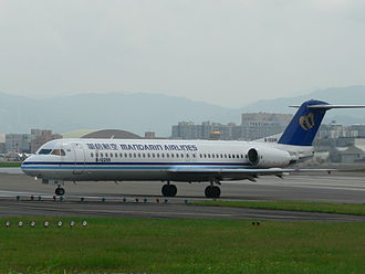 Mandarin Airlines - A Mandarin Airlines Fokker 100 preparing to take off in Taipei Songshan Airport.