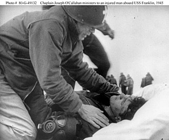 United States Navy Chaplain Corps - Chaplain Joseph T. O'Callahan ministers to an injured man aboard USS Franklin, 1945.