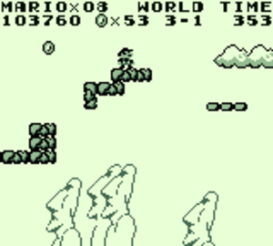 Super Mario Land - Mario stands atop a platform in a screenshot from the game