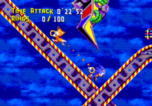 Gameplay screenshot of Sonic Crackers, showing Sonic and Tails in a carnival-esque stage. The tethering mechanic from Sonic Crackers would later surface in Knuckles' Chaotix.