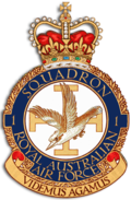 "Crest of 1 Squadron, Royal Australian Air Force, featuring a diving kookaburra before the Jerusalem cross, and the motto ""Videmus Agamus"""