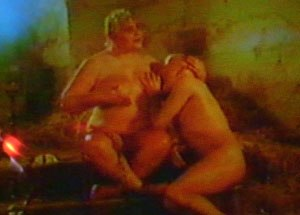 Sycorax - Claire Davenport as Sycorax breastfeeds her adult son Caliban, played by Jack Birkett, in Derek Jarman's film version of The Tempest.