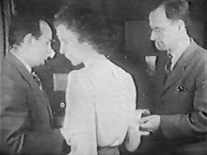Kathleen Antonelli - Kay McNulty hands a print-out of ENIAC results to its inventors Pres Eckert (left) and John Mauchly (right) in a newsreel dating from 1946.