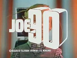 "Bold white lettering forming the words ""Joe 90"" is superimposed over the face of a young, blond-haired boy who has sets of wires connected to his head."
