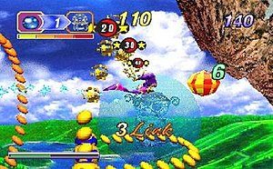 Nights into Dreams - Nights flying through Elliot's first level, Splash Garden, in the Saturn version. From left to right, the interface displays the number of orbs required to proceed, time limit, and score.