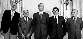 "Plaza Accord - The 1985 ""Plaza Accord"" is named after New York City's Plaza Hotel, which was the location of a meeting of finance ministers who reached an agreement about managing the fluctuating value of the US dollar. From left are Gerhard Stoltenberg of West Germany, Pierre Bérégovoy of France, James A. Baker III of the United States, Nigel Lawson of Britain, and Noboru Takeshita of Japan."