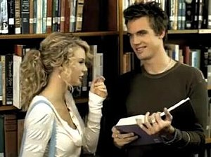 """Teardrops on My Guitar - Swift and Drew (portrayed by Tyler Hilton) laughing in a library in the music video for """"Teardrops on My Guitar"""""""