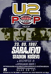 "A dark blue rectangular concert poster displayed vertically. At the top is a logo bearing the words ""U2 POPMART"", with ""Tour '97"" in small print beneath. Across the middle are 4 high-contrast, monochrome headshots of individual men's faces. Beneath is bold text reading ""23. 09. 97."", ""Sarajevo"", and ""Stadion Kosevo"". Near the bottom in small print are other various concert details."