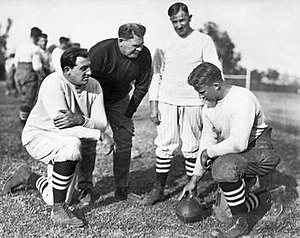 1924 Stanford football team - Line coach Claude E. Thornhill, head coach Pop Warner, assistant Andrew Kerr, and team captain Jim Lawson