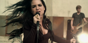 """Disaster (song) - JoJo as she is performing with her band in the music video for """"Disaster"""""""