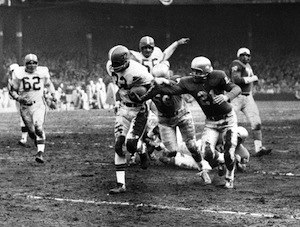 History of the Cleveland Browns - Cleveland Browns rookie Jim Brown shakes off three tacklers and runs 29 yards for a touchdown in the 1957 NFL championship game. Brown led the league in rushing in all but one season in his career.