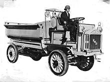 Promotional photo of Luella Bates driving a FWD model B truck.