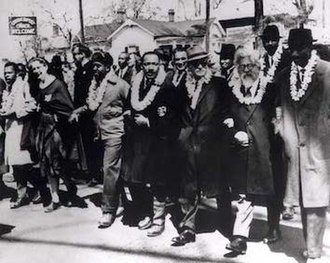 "Selma to Montgomery marches - The 3rd Selma Civil Rights March frontline. From far left: John Lewis, an unidentified nun; Ralph Abernathy; Martin Luther King, Jr.; Ralph Bunche; Rabbi Abraham Joshua Heschel; Frederick Douglas Reese. Second row: Between Martin Luther King, Jr. and Ralph Bunche is Rabbi Maurice Davis. Heschel later wrote, ""When I marched in Selma, my feet were praying."""