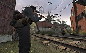 Day of Defeat: Source - A German rifleman takes aim. The destroyed train station in the background forms one of the game's strategic points.