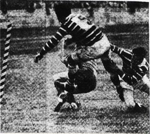 1951 NSWRFL season - Manly's Ron Rowles and Gordon Willoughby trying to stop Souths Winger Johnny Graves from scoring the first of his four tries.