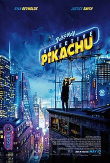 The film title is a neon sign on a rooftop in a nighttime cityscape. On the rooftop, beneath the sign stands a man with a yellow creature sitting on his shoulders.