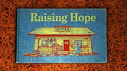 The cover of a blue storybook, with the words 'Raising Hope' written in yellow above a picture of a house.