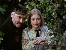 "Ray Smith (1936–1991) as the blacksmith Willie Davidson with Judi Bowker as Vicky Gordon in the episode ""The Horsemen"" in the series ""Adventures of Black Beauty"".jpg"